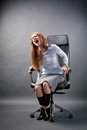 Tied up businesswoman shouting for help a young secretary or business assistant to an office chair screaming Stock Photography