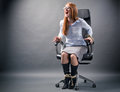 Tied up woman no freedom in business a young businesswoman confined to an office chair shouting for help and trying to free Royalty Free Stock Photos