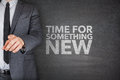 Tiem for something new on blackboard time with businessman Royalty Free Stock Image