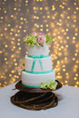 Tier wedding cake with fresh flowers Stock Photo