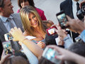 Tiff toronto september jennifer aniston signs autographs for fans at the toronto international film festival for her new film life Royalty Free Stock Photo