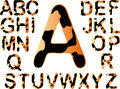 Tiger alphabet with black splats all seperatley grouped letters and hand created Royalty Free Stock Image