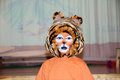 Tiger costume for school performance. mask for child.Children face painting. Boy  painted as tiger or ferocious lion. Boy actor Royalty Free Stock Photo