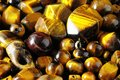 Tiger eye stones ready to make handmade jewelry Royalty Free Stock Photos