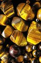 Tiger eye stones ready to make handmade jewelry Stock Photos