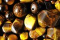Tiger eye stones ready to make handmade jewelry Stock Image