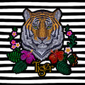 Tiger head tropic flower. Front view embroidery patch sticker. Orange striped black wild animal stitch texture textile print. Jung