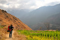Tiger leaping gorge man hiking in Stock Photos