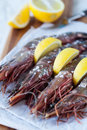 Tiger shrimp with lemon giant sized king prawns garnish shallow dof Stock Image