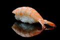 Tiger shrimp sushi on black reflecting background Royalty Free Stock Image