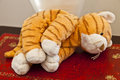 Tiger soft toy sad looking laying on its side Royalty Free Stock Photography