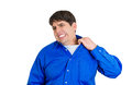 In tight spot closeup portrait of young business man opening shirt to vent it s hot unpleasant awkward situation embarrassment Royalty Free Stock Image