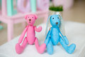 Tilde toy blue handmade rabbit and pink teddy Stock Photography