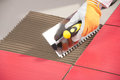 Tile adhesive worker Royalty Free Stock Photo