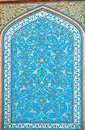 Tile patterns on a beautiful blue color wall of historical persian house in Isfahan, Iran. Royalty Free Stock Photo