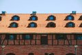 Tile roof with windows of an old brick house red Royalty Free Stock Photos