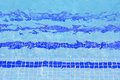 Tile stairs in the blue water of the pool Royalty Free Stock Photos