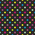Tile vector pattern with colorful polka dots on black background Royalty Free Stock Photo