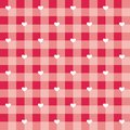 Tile vector pattern with white hearts on red and pink checkered background