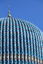 Tiled dome of a mosque with a golden crescent Royalty Free Stock Photo