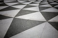 Tiled floor with black and grey triangular pattern Royalty Free Stock Images