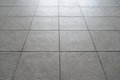 Tiled floor gray in building Royalty Free Stock Photos