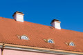 Tiled roof with chimneys and mansard windows Royalty Free Stock Photo