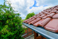 Tiled roof of wooden arbor with galvanized gutter Stock Photography