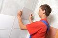 Tiler at home renovation work Royalty Free Stock Photo