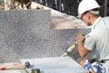 Tiler sealing joints between ceramic tiles Royalty Free Stock Photo