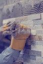 Tilers hands gluing brick decorations