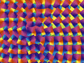 Tiles in spectral colors swirling pattern background Stock Photo