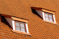 Tiling roof with windows Royalty Free Stock Photo