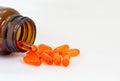 Tillägg för vitamin e capsules closeupen på en vitbakgrund Fotografering för Bildbyråer