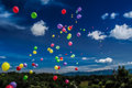 Tilt shift balloon release a effect is used on balloons full of helium mid on a sunny day Stock Images