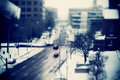 Tilt shift shot snowy traffic intersection blue tint blur Royalty Free Stock Images