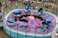 Tilt a whirl ride the w is classic carnival that has been around for years Royalty Free Stock Images