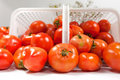 Tilted Tomatoe Basket Stock Image