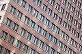 Tilted view pattern windows tall building Stock Image
