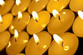 A tilted view of tealight candles Stock Images