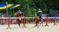Tilting knights two armored ride at one another in a jousting match during a renaissance festival Stock Photography
