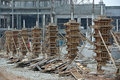 Timber column formwork under construction at the construction site selangor malaysia – august workers using tubes and wood as a Royalty Free Stock Images