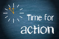 Time for action text written in white letters on a black chalk board with a clock to one side showing minutes to midnight concept Royalty Free Stock Image