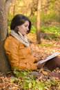 Time for books in the autumn forest young beautiful girl with a book Royalty Free Stock Images