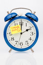 Time changeover to summer time an alarm clock with a note as a reminder the uhrumstellung at Stock Image
