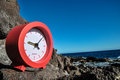 Time concept alarm clock on the volcanic rocks Stock Photos