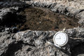 Time concept classic vintage pocket clock on the volcanic rocks Royalty Free Stock Photo