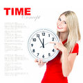 Time concept five to twelve young beautiful woma woman with big clock on white background with sample text Royalty Free Stock Photo