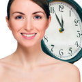 Time concept portrait of beautiful smiling young woman Royalty Free Stock Images
