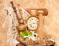 Time concept still life antique clock oil lamp and vase on the oid chair Stock Images